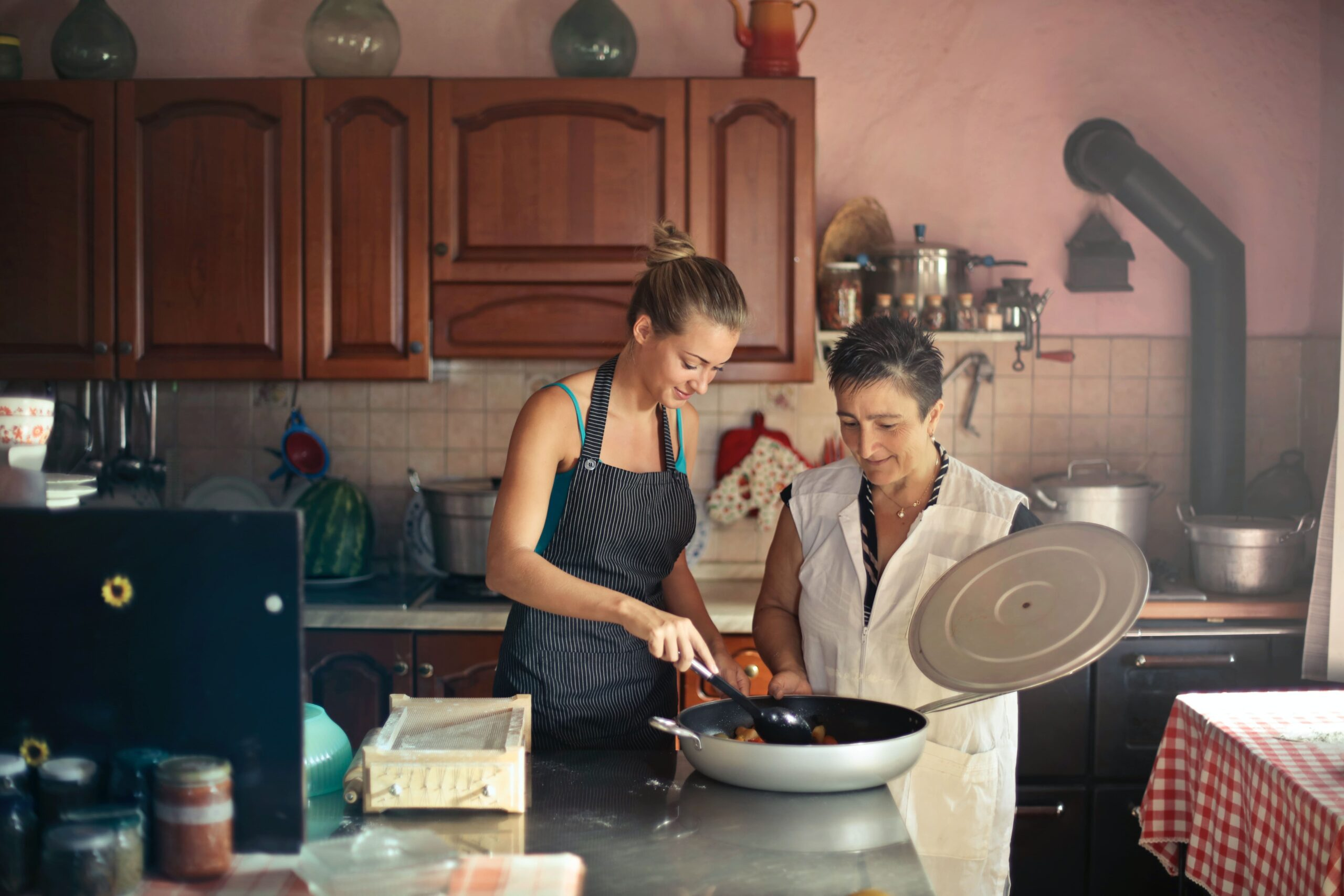 Older and younger woman cooking together